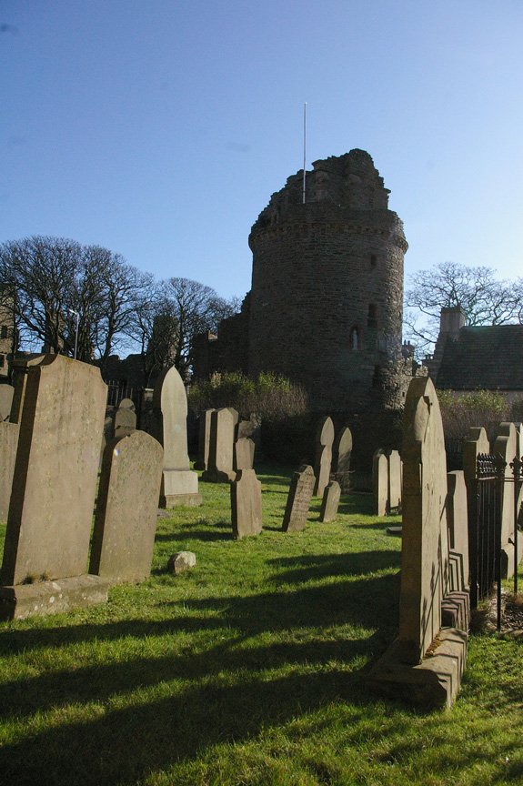The Bishop's residence looms over St. Magnus Cathedral's cemetery